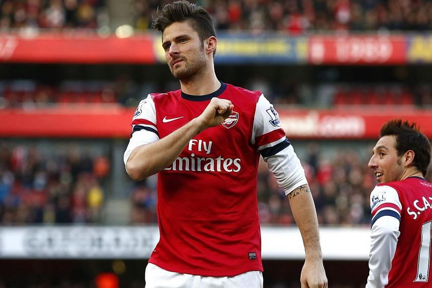 Arsenal's Olivier Giroud celebrating his goal against Sunderland during their English Premier League match at the Emirates Stadium in London on Feb 22, 2014. Giroud helped Arsenal move on from their frustrating defeat to Bayern Munich and drew a line