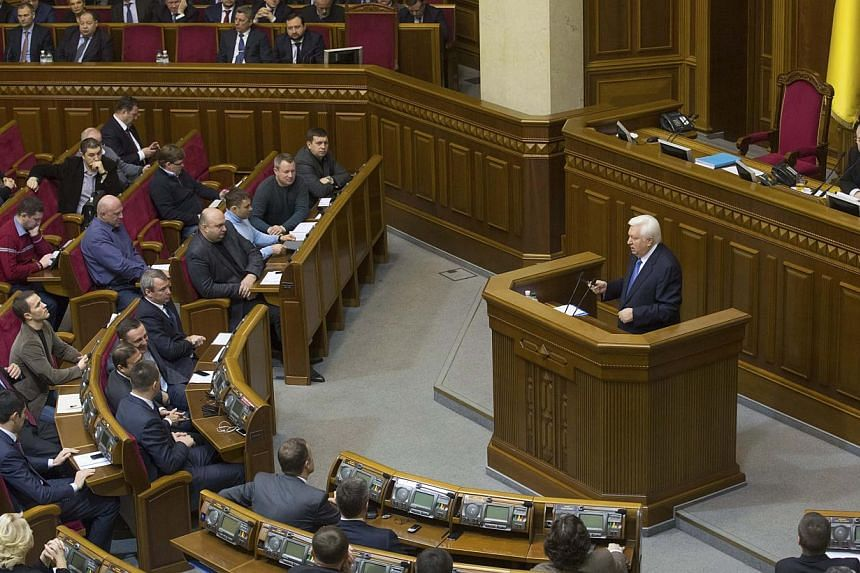 Prosecutor general Viktor Pshonka addresses deputies during a session of the Ukrainian parliament in Kiev December 20, 2013. An order has been given to arrest Ukraine's former incomes minister Oleksander Klimenko and former prosecutor-general Viktor