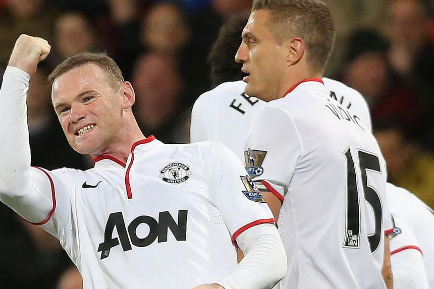 Manchester United's Wayne Rooney (left) celebrates scoring with team mates during their English Premier League soccer match at Selhurst Park, London on Feb 22, 2014. -- PHOTO: REUTERS