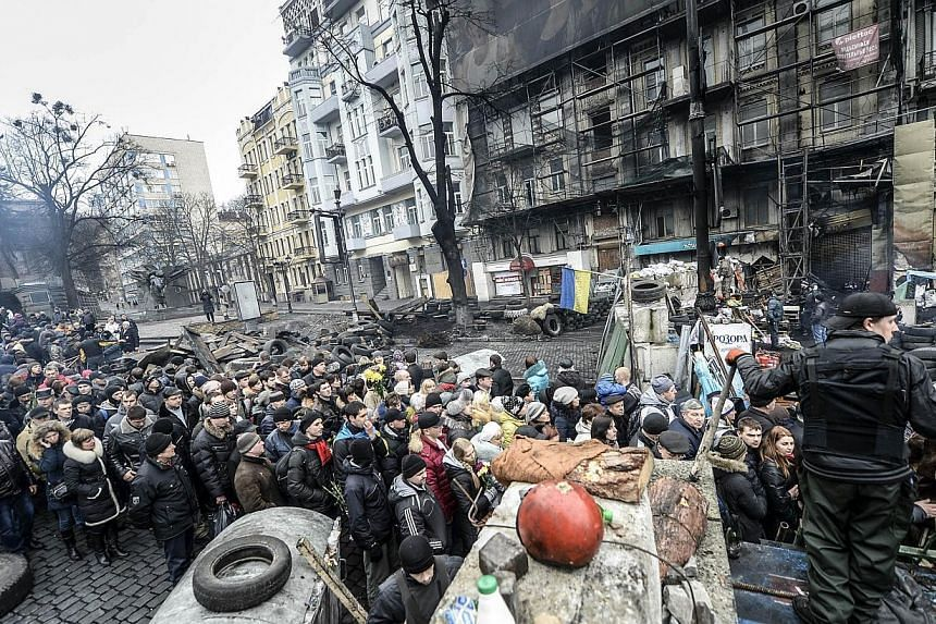 Thousands of people come to visit Kiev's Independence square on Feb 23, 2014.A new era dawned in Ukraine on Sunday when parliament appointed a pro-Western interim leader after impeaching a defiant president Viktor Yanukovych, whose whereabouts