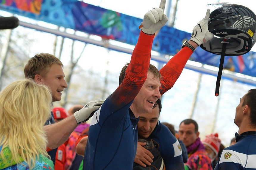 Russia-1 four-man bobsleigh, pilot Alexander Zubkov celebrates in the Bobsleigh Four-man Heat 4 and final run at the Sanki Sliding Center during the Sochi Winter Olympics on Feb 23, 2014.Zubkov secured a golden finale for the Sochi Games hosts