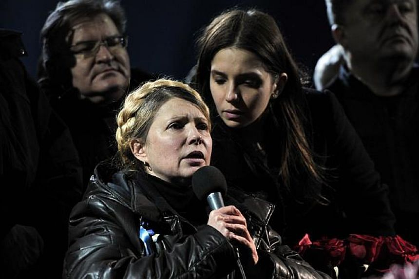 Newly freed Ukrainian opposition icon and former prime minister Yulia Tymoshenko (front), with her daughter Yevgenia at her side, speaks during a rally on Kiev's Independance square on Feb 22, 2014, after her release. Tymoshenko, freed from pris