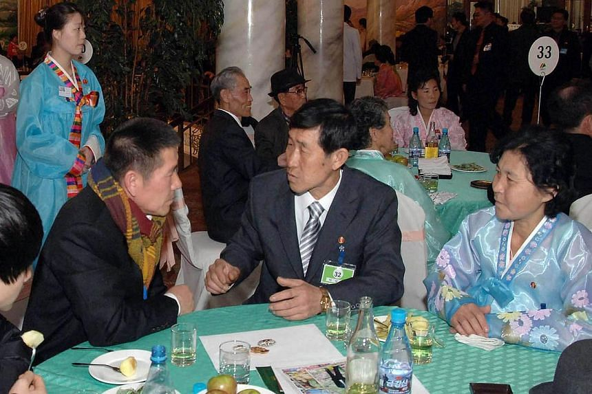 This recent undated picture released from North Korea's official Korean Central News Agency (KCNA) on Feb 22, 2014 shows the reunion of separated families and relatives from North and South Korea meeting in Mount Kumgang Resort from Feb 20, 2014. A s