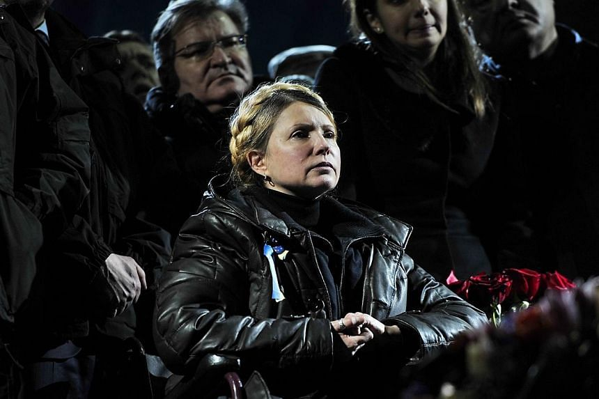 Newly freed Ukrainian opposition icon and former prime minister Yulia Tymoshenko looks on as she delivers a speech on Kiev's Independance square on Feb 22, 2014. -- PHOTO: AFP