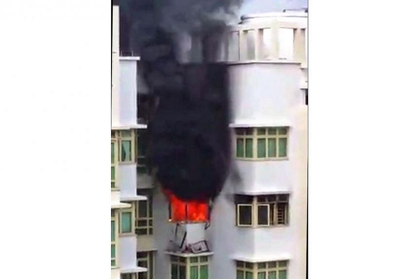 A woman in her 60s and a four-year-old were evacuated from a flat in Punggol on Monday morning after a fire broke out in the flat. -- PHOTO: ST READER