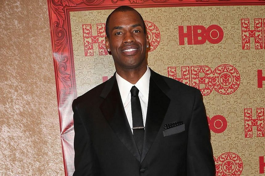Jason Collins signed a 10-day contract with the NBA's Brooklyn Nets on Sunday, Feb 23, 2014, to become the first openly gay man playing in a major US professional sports league. -- PHOTO: AFP