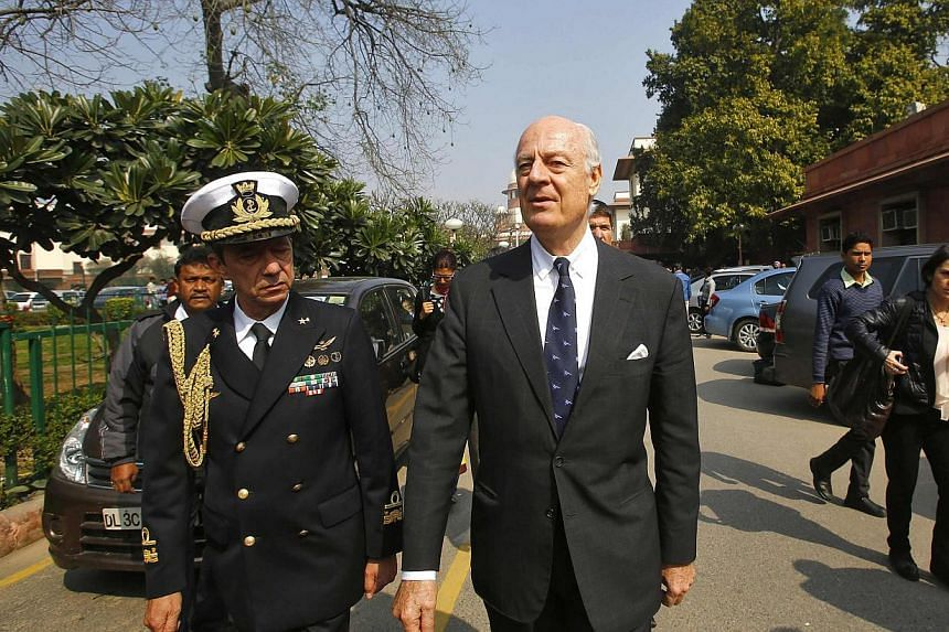 Italian special envoy Staffan de Mistura (R) and military attache Franco Faure walk on the premises of India's Supreme Court after a hearing in New Delhi on February 18, 2014. Italy recalled its ambassador to India on Tuesday after the Supreme Court