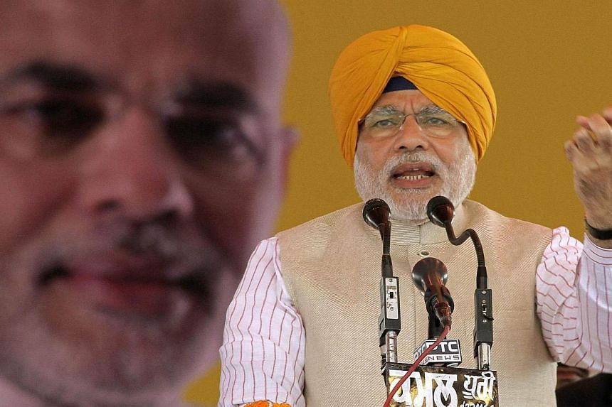 Hindu nationalist Narendra Modi, prime ministerial candidate for India's main opposition Bharatiya Janata Party (BJP) and Gujarat's chief minister, addresses his supporters during a rally at Jagraon in Ludhiana, in the northern Indian state of Punjab