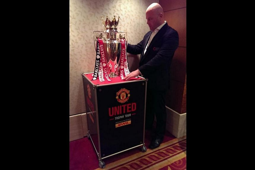 Football fans will have the chance to get up close and personal with the English Premier League trophy and Manchester United legend Gary Pallister on Tuesday evening, as part of the club's Trophy Tour.  -- ST PHOTO: FABIUS CHEN