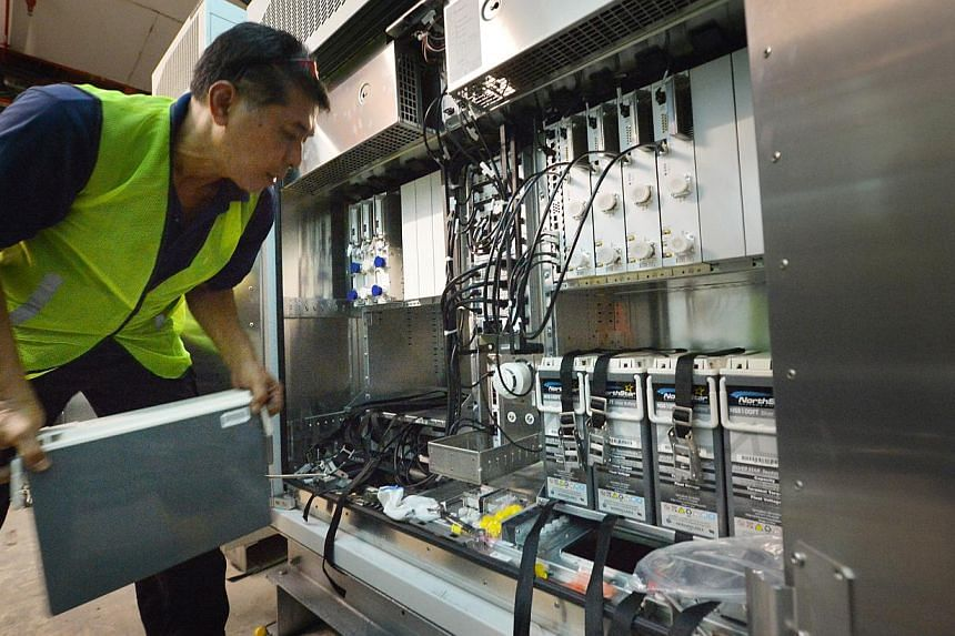 Staff from SingTel installing a base station at the Junction 8 shopping mall in Bishan to enhance its indoor 4G network coverage. SingTel, M1 and StarHub 4G mobile customers can expect higher quality and clearer voice calls than they do now on 3G net