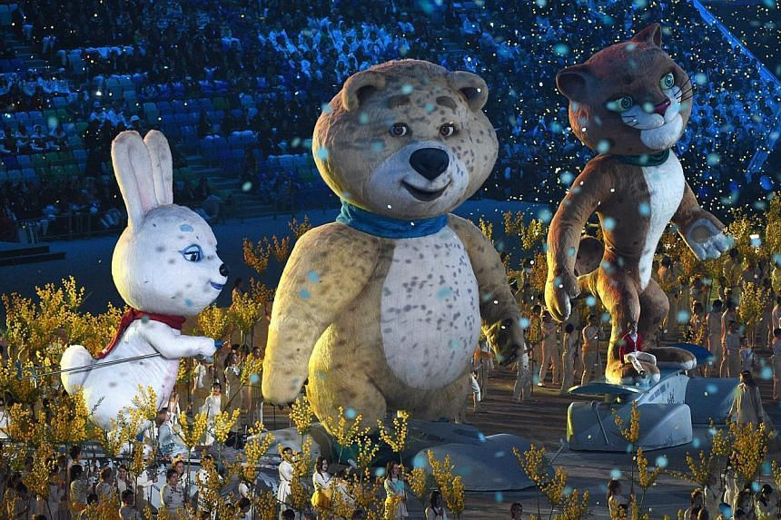 Performers stand near to the rabbit, polar bear, and leopard Winter Olympic mascots as they take part in the Closing Ceremony of the Sochi Winter Olympics at the Fisht Olympic Stadium on Feb 23, 2014. -- PHOTO: AFP