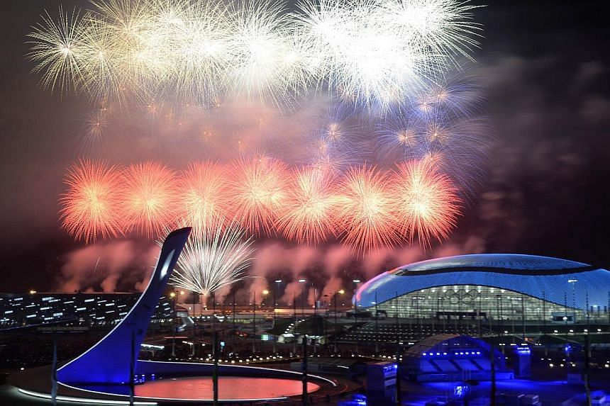 Fireworks explode around the Fisht Olympic Stadium at the end of the Closing Ceremony of the Sochi Winter Olympics on Feb 23, 2014, at the Olympic Park in Sochi. -- PHOTO: AFP