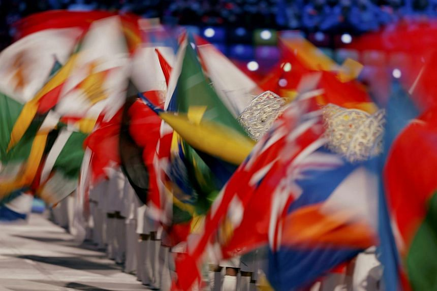 Various national flags are seen during the closing ceremony for the 2014 Sochi Winter Olympics, on Feb 23, 2014. -- PHOTO: AFP