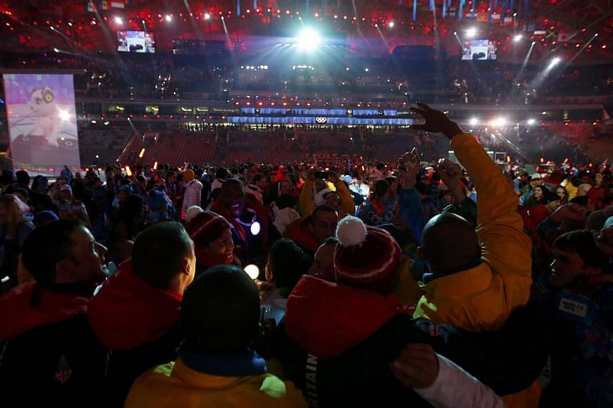 Athletes party on stage after the closing ceremony for the Sochi 2014 Winter Olympic Games on Feb 23, 2014. -- PHOTO: REUTERS