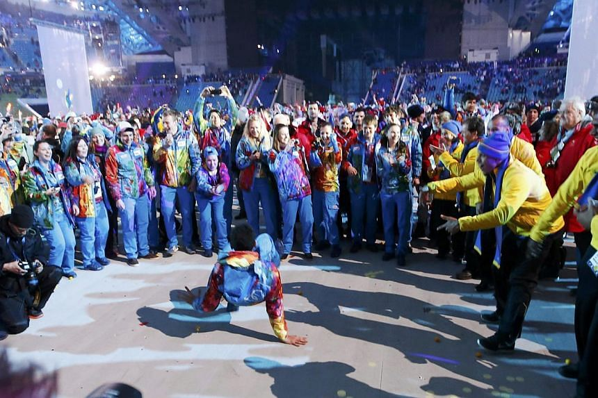 A participant break dances during the party at the end of the closing ceremony for the Sochi 2014 Winter Olympics, on Feb 23, 2014. -- PHOTO: REUTERS