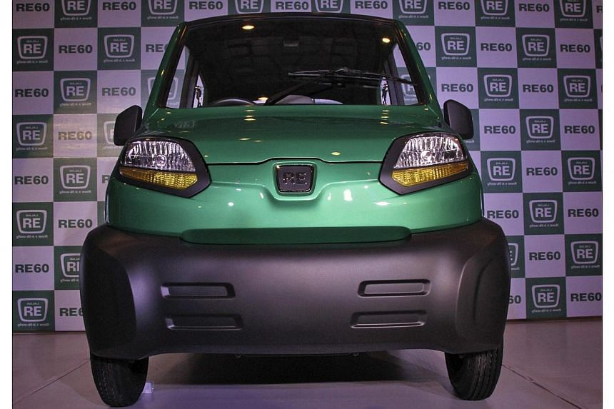 Bajaj's four-wheeled RE60 is pictured in New Delhi in this Jan 3, 2012 file photo. -- FILE PHOTO: REUTERS