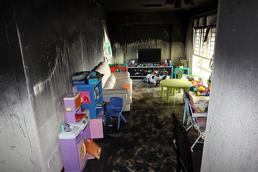 A fire broke out at a 17th storey flat at Blk 167D Punggol East. A woman in her 60s and a 4-year -old boy was injured. -- ST PHOTO: SEAH KWANG PENG