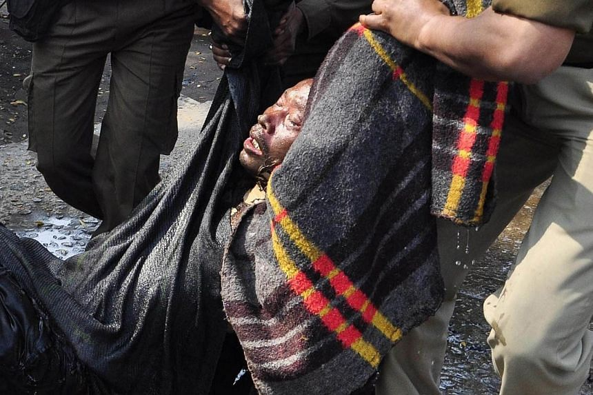 Indian police carry Pranab Boro, an activist of Krisak Mukti Sangram Samiti (KMSS) who self-immolated in a protest demanding land rights for local people in various regions of eastern Assam state, from the front of the Assam Secretariat to hospital i