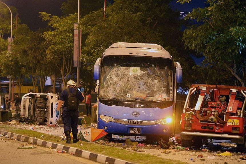 About 20 to 30 foreign workers - some of whom were throwing projectiles - gathered around the bus after it struck an Indian national foreign worker on Dec 8 last year, Certis Cisco constable Nathan Chandra Sekaran told the Committee of Inquiry (COI)