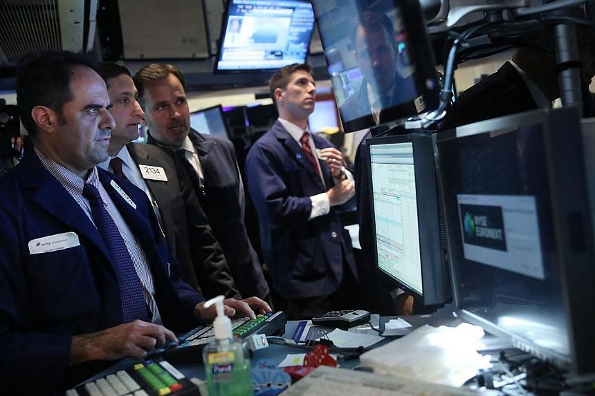 Traders work on the floor of the New York Stock Exchange on Feb 24, 2014 in New York City. United States (US)  stocks rose on Monday and the S&P 500 hit a record intraday high, helped by gains in health insurers' shares and optimism about me