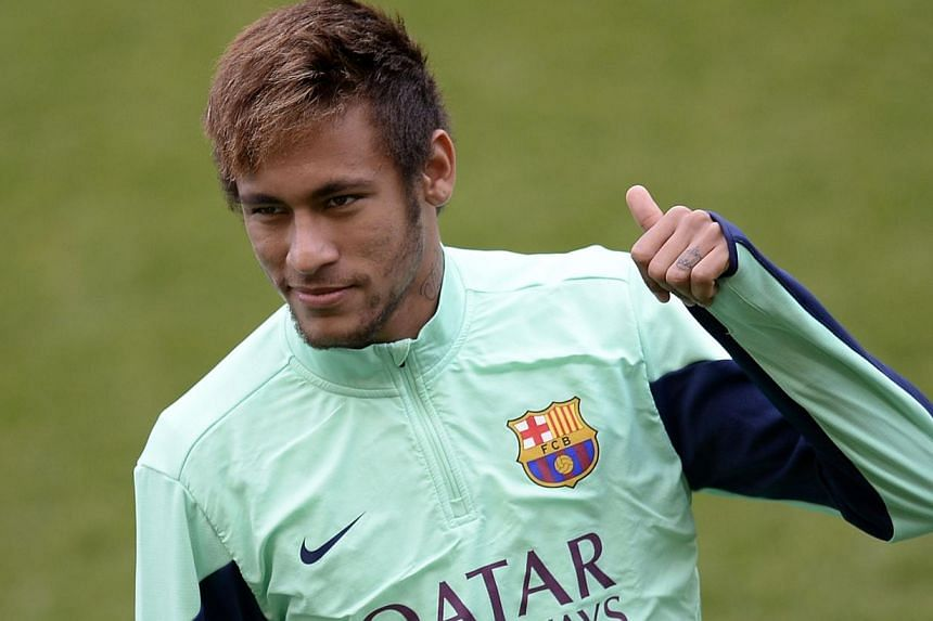 Barcelona's Brazilian forward Neymar da Silva Santos Junior gestures during an open training session at the Mini Stadium in Barcelona on Jan 3, 2014. -- FILE PHOTO: AFP