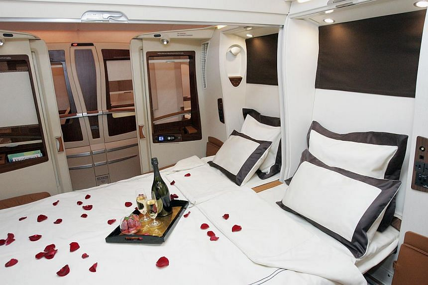 Singapore Airlines' A-380s currently have private cabins that offer a double bed screened off by sliding doors and roller blinds. The airline's existing A-380s will also be progressively retrofitted with the new look. -- ST FILE PHOTO