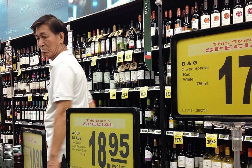 Four supermarket chains have curbed sales of existing stocks of alcoholic drinks since last Friday evening. -- ST PHOTO: NEO XIAOBIN