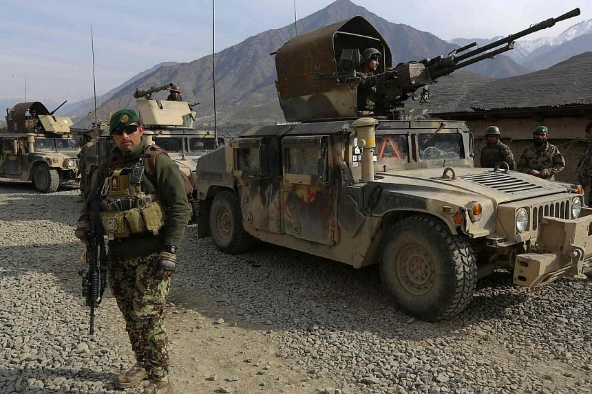 Afghan National Army soldiers keeping watch at the Forward Base in Nari district near the army outpost in Kunar province on Feb 24, 2014. The survey by the firm ATR Consulting found that 80 per cent of Afghans thought that the government was in contr