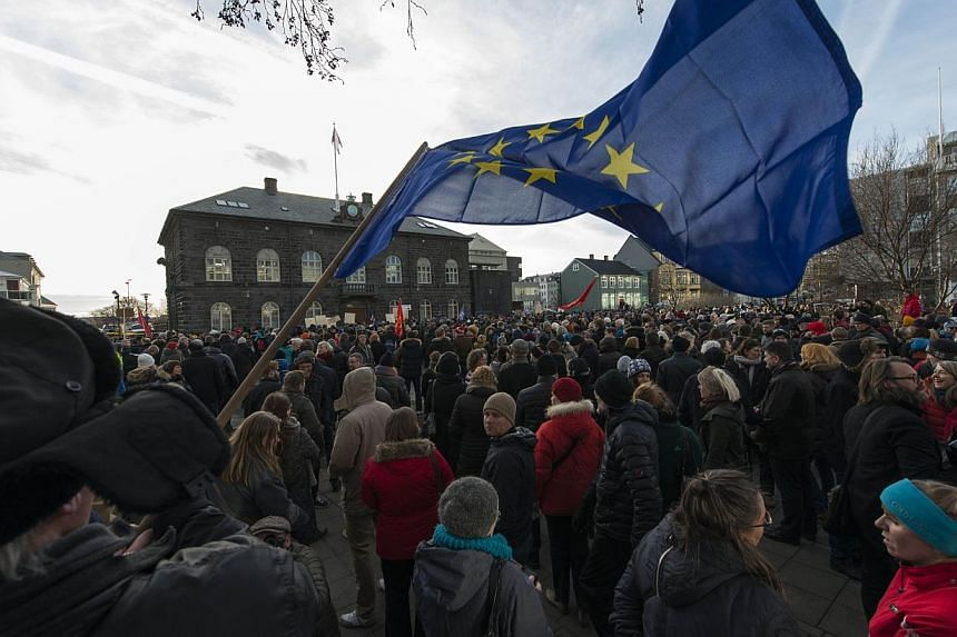 Thousands of protesters gather in front of teh Parliament in the Icelandic capital Reykjavik on Feb 24, 2014 to demand a referendum amid a government bid to pull out of EU accession talks without a popular vote. Thousands of protesters thronged the s