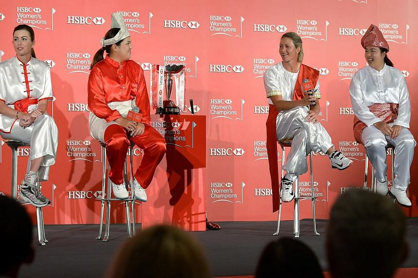 Paula Creamer (left), Inbee Park (centre left), Suzann Pettersen (centre right), and Shanshan Feng (right), at the opening press conference for the HSBC Women's Champions golf tournament. Used to battling each other on greens and fairways, four
