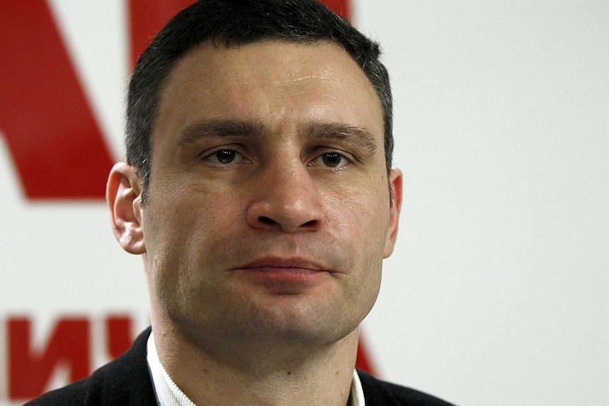 Ukrainian opposition leader and head of the UDAR (Punch) party Vitaly Klitschko listens to a journalist's question during a news conference in Kiev, Feb 23, 2014. Mr Klitschko on Tuesday, Feb 25, 2014, announced that he will run for Ukraine's pr