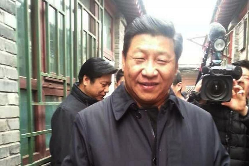 Chinese President Xi Jinping is photographed visiting Nanluoguxiang, a popular street in Beijing, on Feb 25, 2014. MrXi shocked locals by visiting courtyard homes and chatting with pedestrians near a popular shopping street on Tuesday, Feb 25,