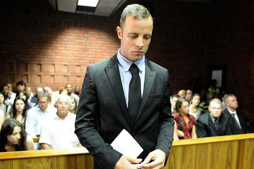 A file photo taken on Feb 20, 2013, shows South African Olympic sprinter Oscar Pistorius appearing at the Magistrate Court in Pretoria. A South African judge ruled on Tuesday, Feb 25, 2014, that media may film and broadcast parts of Paralympic s
