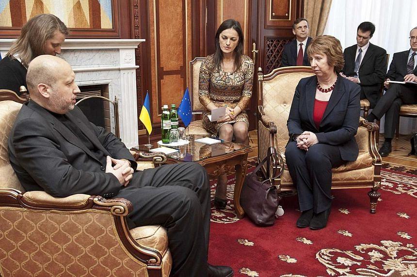 European Union foreign policy chief Catherine Ashton (right) with Ukraine's interim President Oleksander Turchynov during their meeting in Kiev, Feb 24, 2014. -- PHOTO: REUTERS