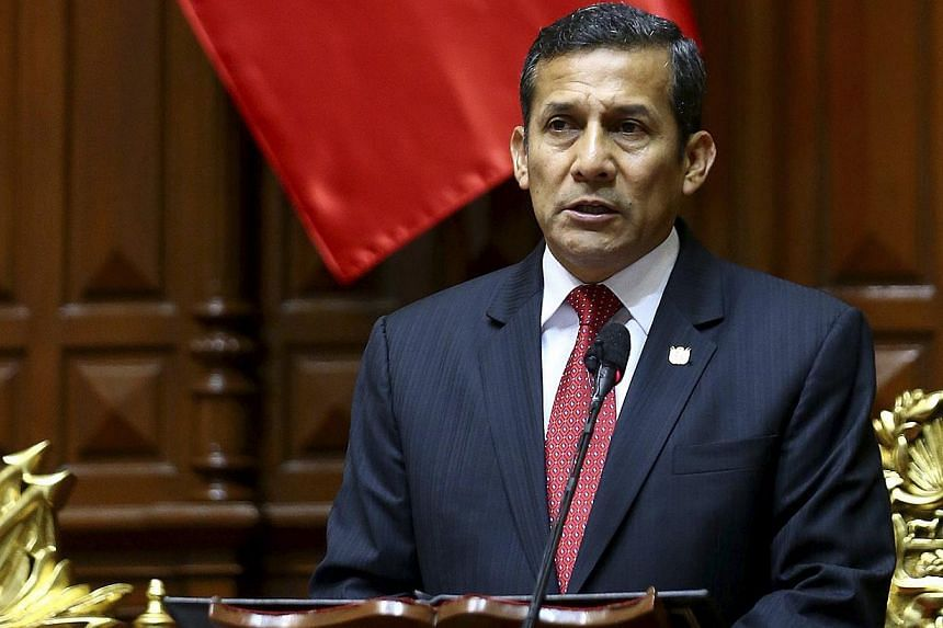 Peru's President Ollanta Humala (above) named his housing minister as his fifth prime minister on Monday in a Cabinet shuffle that reappointed his widely respected finance but replaced his energy and mines minister. -- FILE PHOTO: REUTERS