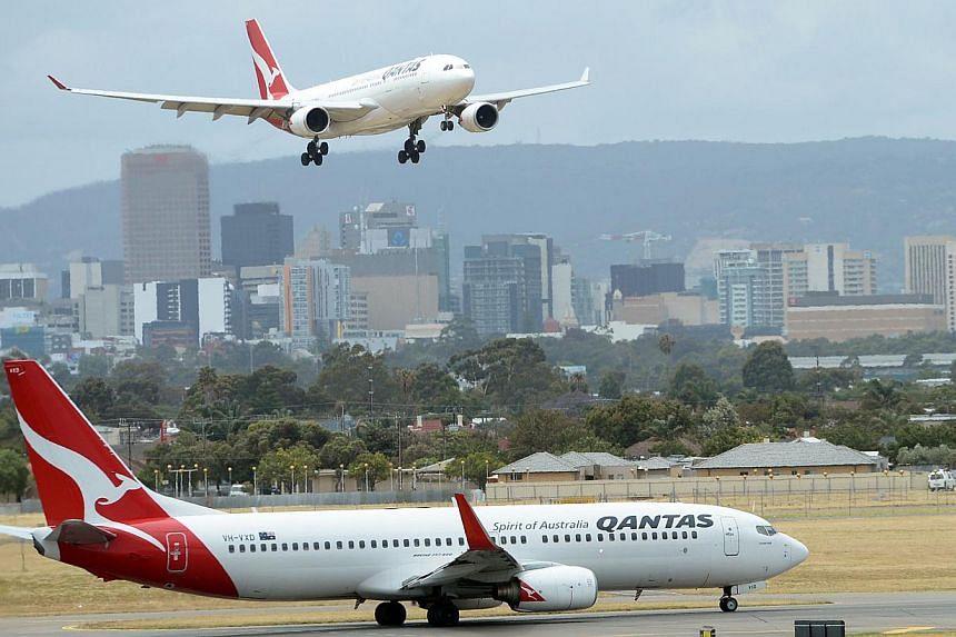 Qantas aircrafts at Adelaide airport on Dec 10, 2013. -- FILE PHOTO: AFP