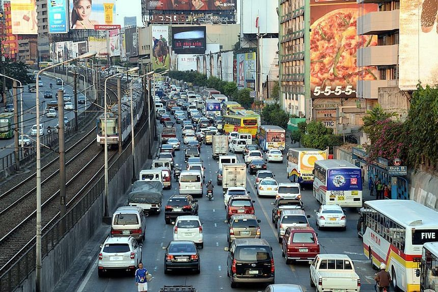 Rush-hour traffic starts to build up along Metro Manila's main Edsa highway, on Feb 19, 2014. Transportation experts estimate that traffic costs the Philippines roughly 140 billion pesos (S$3.96 billion) a year, mostly in missed business opportunitie