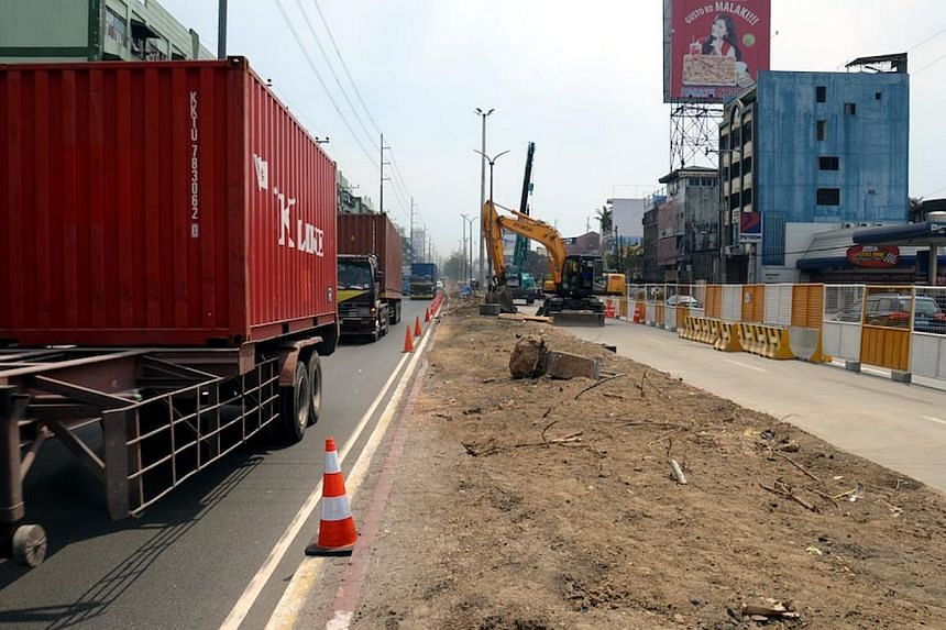 """Construction work begins on the third stage of an elevated highway known as the """"Skyway"""" in Metro Manila. The Philippines is considering unorthodox measures like compelling companies to let their staff work from home to ease massive traffic jams that"""
