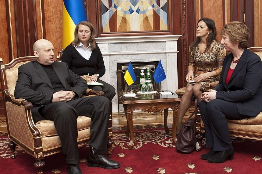 """European Union foreign policy chief Catherine Ashton (right) sits with Ukraine's interim President Oleksander Turchynov during their meeting in Kiev on Feb 24, 2014.Ukraine's interim president on Tuesday warned of """"dangerous signs"""" of separatis"""