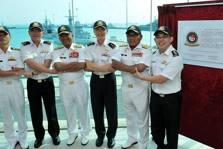 RADM Ng Chee Peng (third from right) and Admiral Tan Sri Abdul Aziz (third from left), as well as senior commanders from the Republic of Singapore Navy (RSN) and Royal Malaysian Navy (RMN) with the new Exercise Malapura logo. -- PHOTO: MINDEF