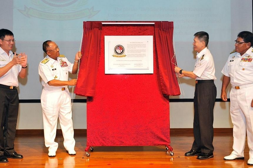 RADM Ng Chee Peng (second from right) and Admiral Tan Sri Abdul Aziz (second from left) unveiling the new Exercise Malapura logo as RSN's Fleet Commander RADM Timothy Lo (left) and RMN's Fleet Operations Commander Vice-Admiral Dato' Abd Hadi bi