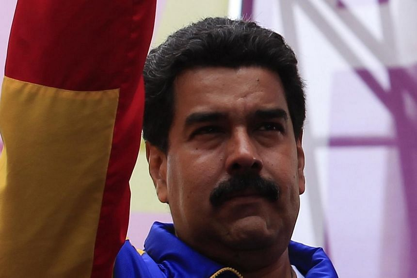 Venezuela's President Nicolas Maduro greets supporters during a rally in Caracas on Monday, Feb 24, 2014. Venezuela, which has been at odds with the United States for years and announced the expulsion of three US diplomats last week, will nomina
