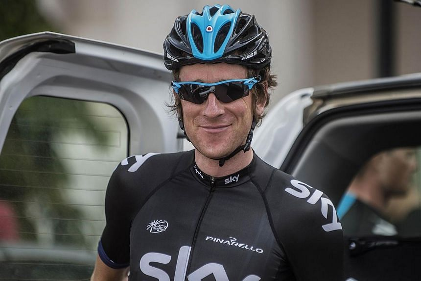 Britain's cyclist Bradley Wiggins of Sky Procycling Team poses before the start of the fifth stage of the cycling Tour of Oman, in the Omani capital Muscat.Olympic champion and 2012 Tour de France winner Bradley Wiggins says he intends to ride