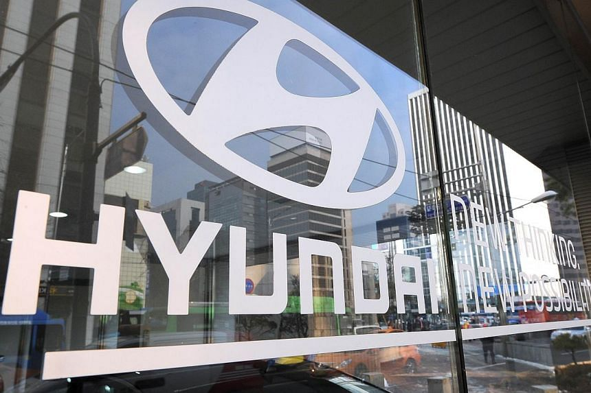 The logo of Hyundai Motor is seen on the glass door at its branch in Seoul on Jan 23, 2014. -- FILE PHOTO: AFP