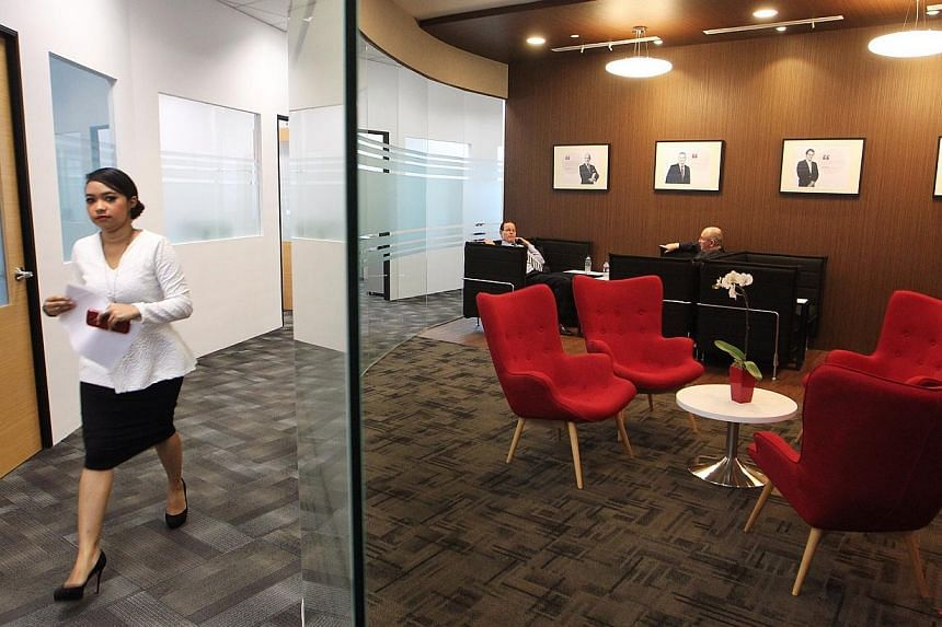 Guests seen in the Leadership lounge at the official opening of LSBF's new Singapore campus at the Springleaf Tower on Feb 26, 2014.-- ST PHOTO: NEO XIAOBIN