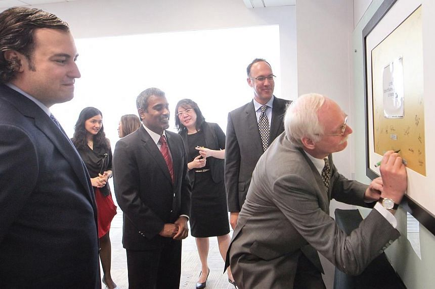 LSBF in Singapore's Managing Director Rathakrishnan Govind (third from left), British High Commisioner to Singapore H.E. Antony Phillipson (second from right), and LSBF Executive Chairman and Founder Arkady Etingen (extreme left) watch as LSBF's CEO