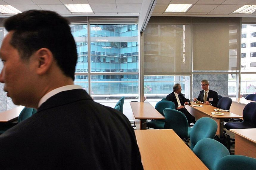 Guests enjoy a lunch reception in one of the classrooms at the official opening of LSBF's new Singapore campus at the Springleaf Tower on Feb 26, 2014.-- ST PHOTO: NEO XIAOBIN