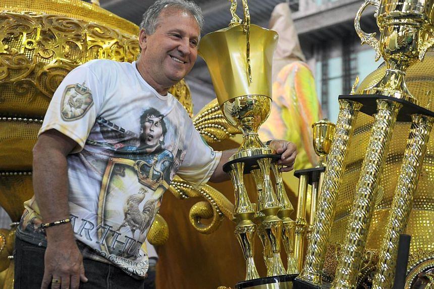 "Former Brazilian football star, Arthur Antunes Coimbra, aka ""Zico"", poses on a float at the Imperatriz Leopoldinense samba school in Rio de Janeiro, Brazil, on Feb 13, 2014. -- FILE PHOTO: AFP"
