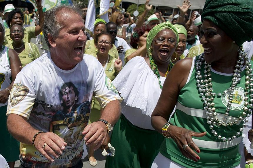 "Former Brazilian football star, Arthur Antunes Coimbra, aka ""Zico"" (left) dances with members of the Imperatriz Leopoldinense samba school at Samba City in Rio de Janeiro, Brazil, on Feb 13, 2014. -- FILE PHOTO: AFP"