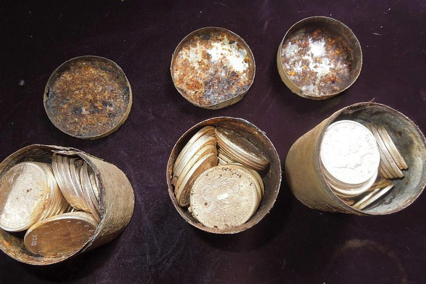 Cans containing 19th century gold coins are shown in this undated handout photo courtesy of Kagin's Inc. A California couple out walking their dog struck it rich by unearthing a horde of buried gold coins, worth more than US$10 million (S$12.6 millio